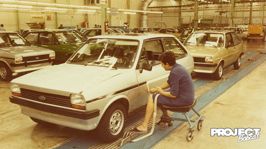 Ford Fiesta side stripes being applied by a factory worker