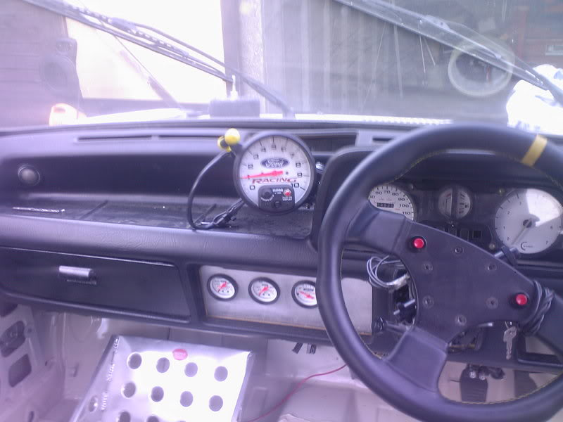 Racing steering wheel fitted to a retro ford fiesta