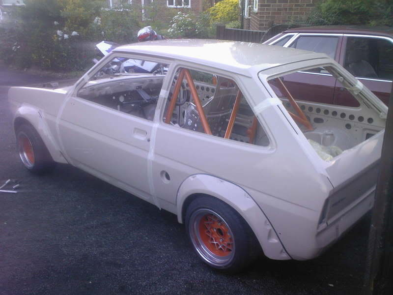 beige and orange widearched Mk1 Fiesta