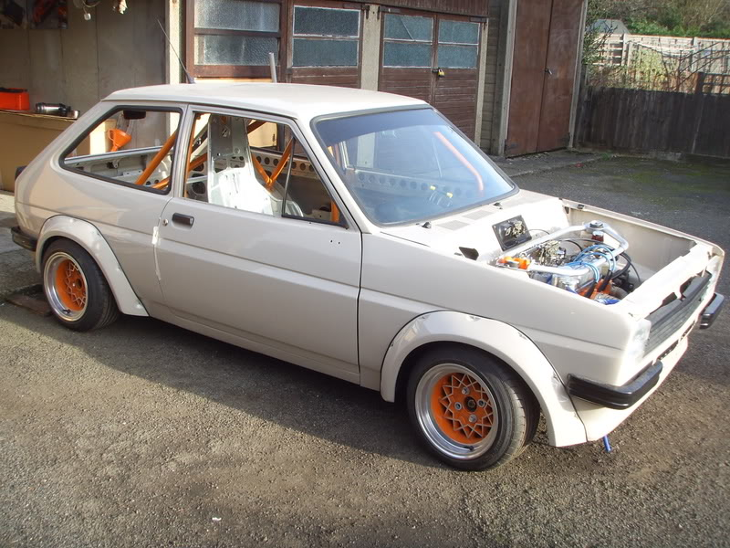 Beige Mk1 fiesta with orange alleycat wheels