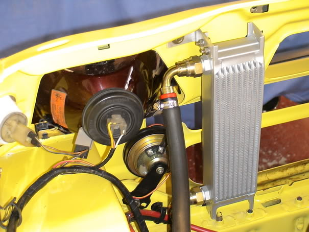Vertically mounted oil cooler