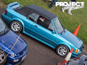 Turquoise Ford Escort XR3i Cabriolet with black roof