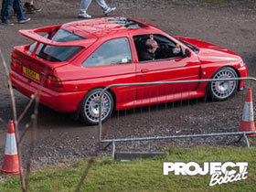 Escort Cosworth E9GYY driving into Squires Cafe Ford show