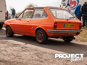 CUY450W Orange Mk1 Fiesta with chrome bumpers